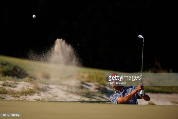 Ricky Castillo of Team USA plays his shot from the bunker on the 14th hole during Saturday singles matches of Day One of The Walker Cup at Seminole...