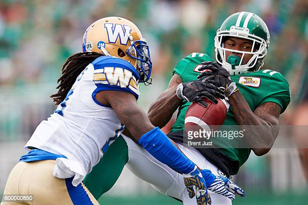 Ricky Collins Jr #3 of the Saskatchewan Roughriders makes a catch at the sideline in the game between the Winnipeg Blue Bombers and Saskatchewan...