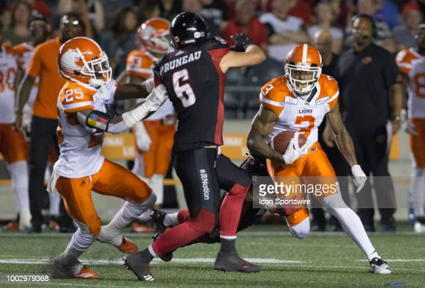 Ricky Collins Jr of the BC Lions tries to turn upfield against the Ottawa Redblacks in Canadian Football League action at Ottawa's TD Place Stadium