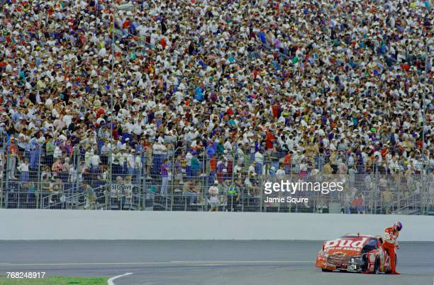 Ricky Craven climbs from the Hendrick Motorsports Budweiser Chevrolet Monte Carlo following a crash during the 1997 NASCAR Winston Cup Series...