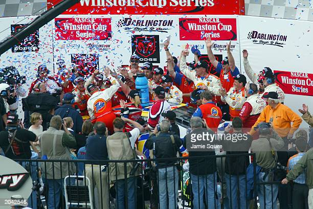 Ricky Craven driver of the Tide Pontiac celebrates with teammates in Victory Lane after winning the NASCAR Carolina Dodge Dealers 400 on March 16...