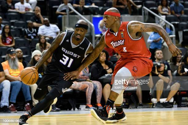 Ricky Davis of Ghost Ballers dribbles the ball past Al Harrington of Trilogy during the Big3 week 6 game between Ghost Ballers and Trilogy on July 27...