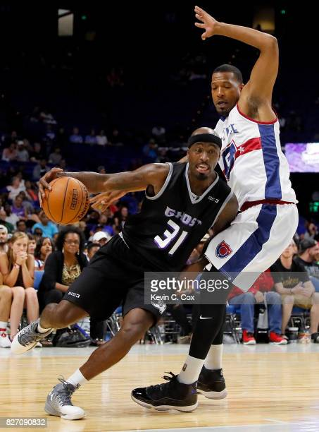 Ricky Davis of Ghost Ballers drives past Dominic McGuire of TriState during week seven of the BIG3 three on three basketball league at Rupp Arena on...