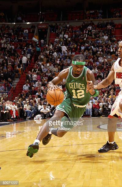 Ricky Davis of the Boston Celtics drives against the Miami Heat during the game on December 21 2004 at American Airlines Arena in Miami Florida The...
