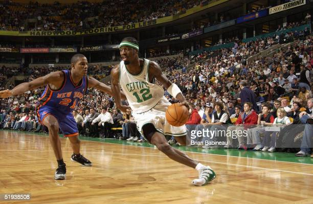 Ricky Davis of the Boston Celtics drives Trevor Ariza of the New York Knicks during the game at the FleetCenter on December 22 2004 in Boston...