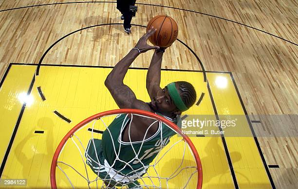 Ricky Davis of the Boston Celtics goes for a dunk during the Sprite Rising Stars Slam Dunk Competition February 14 2004 at the Staples Center in Los...