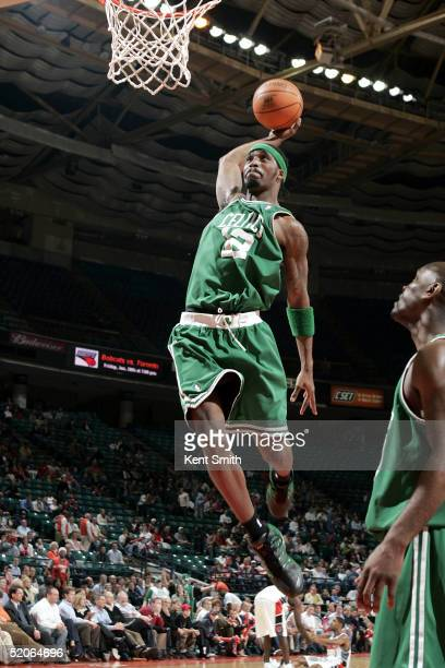 Ricky Davis of the Boston Celtics goes up for a dunk against the Charlotte Bobcats on January 25 2005 at the Charlotte Coliseum in Charlotte North...