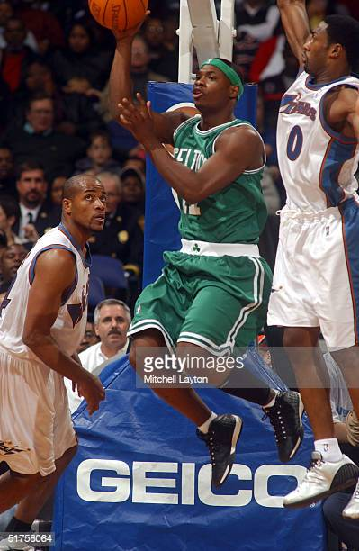 Ricky Davis of the Boston Celtics jumps to the basket against the Washington Wizards during NBA action on November 17 2004 at the MCI Center in...