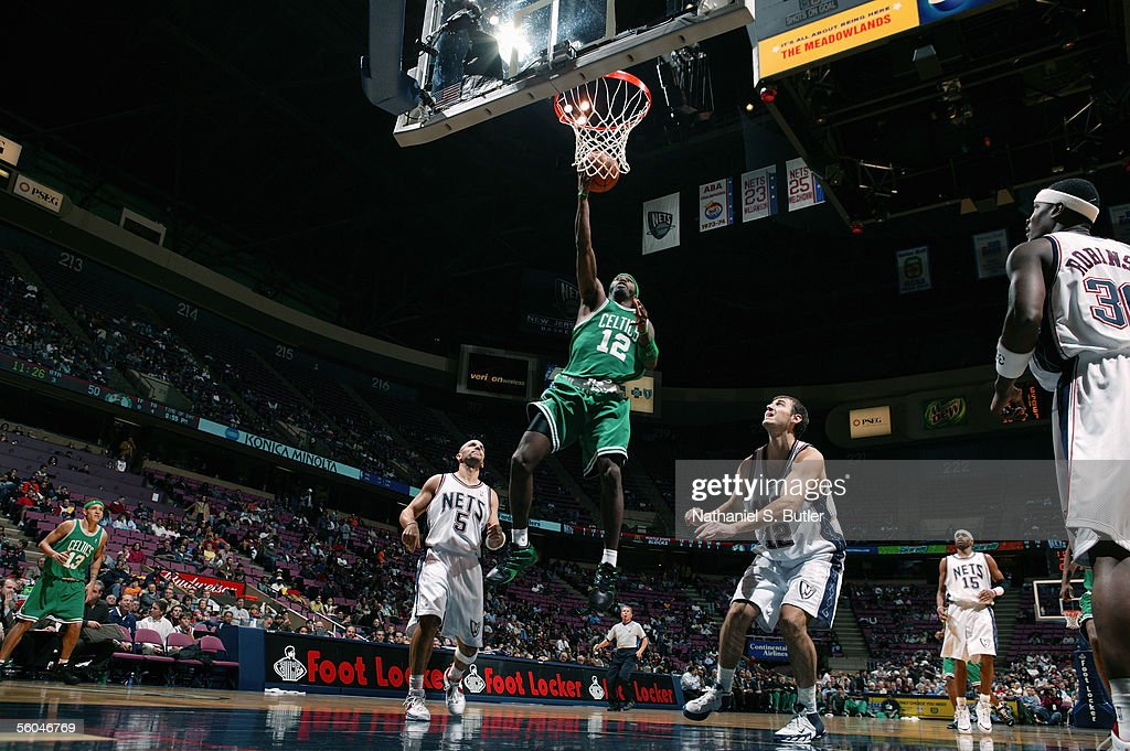 new arrival 7a81a 5b464 Ricky Davis of the Boston Celtics lays the ball up over ...
