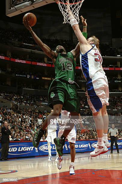 Ricky Davis of the Boston Celtics takes the ball to the basket against Chris Kaman of the Los Angeles Clippers during the game on December 31 2005 at...
