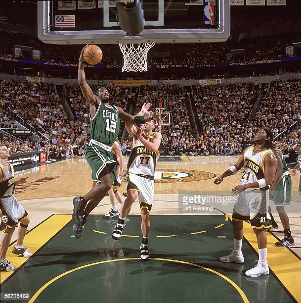 Ricky Davis of the Boston Celtics takes the ball to the basket against Vladimir Radmanovic of the Seattle Sonics during the game at Key Arena on...