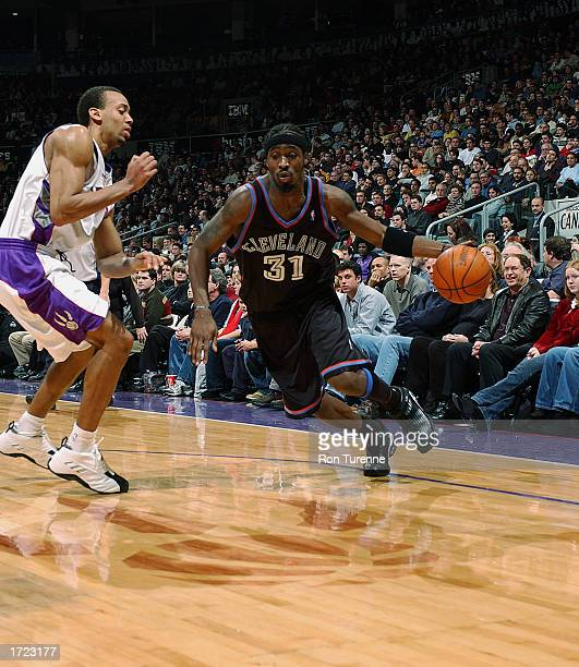 Ricky Davis of the Cleveland Cavaliers drives to the basket during the NBA game against the Toronto Raptors at Air Canada Centre on January 3 2003 in...