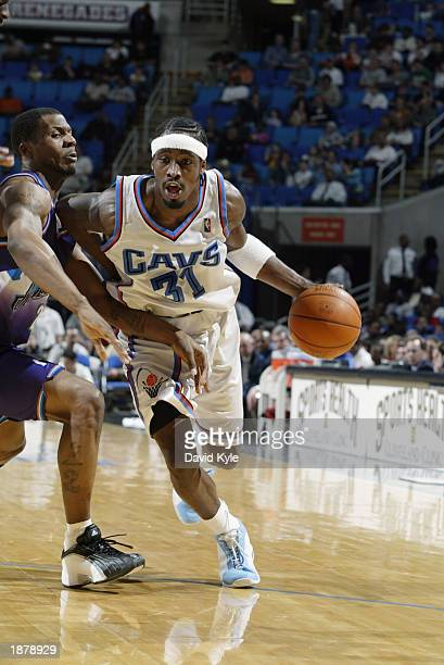 Ricky Davis of the Cleveland Cavaliers drives to the basket during the NBA game against the Utah Jazz at Gund Arena on March 16 2003 in Cleveland...