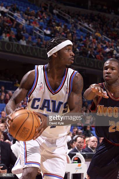 Ricky Davis of the Cleveland Cavaliers looks for a pass as Calber Cheaney of the Denver Nuggets guards him during the second quarter at Gund Arena in...
