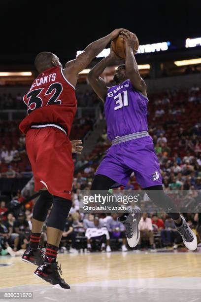Ricky Davis of the Ghost Ballers is blocked by Rashad McCants of the Trilogy in week nine of the BIG3 threeonthree basketball league at KeyArena on...