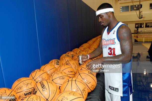 Ricky Davis of the Los Angeles Clippers autographs basketballs during NBA Media Day on September 29 2008 at the Clippers Training Facility in Playa...
