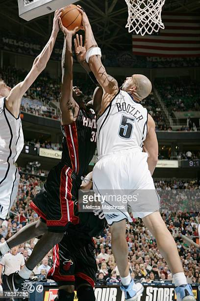 Ricky Davis of the Miami Heat is blocked by Andrei Kirilenko and Carlos Boozer of the Utah Jazz at EnergySolutions Arena December 3 2007 in Salt Lake...