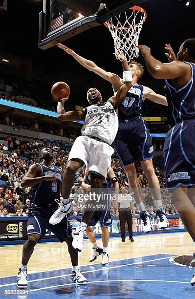 Ricky Davis of the Minnesota Timberwolves attempts to shoot a layup past Andrei Kirilenko of the Utah Jazz during a game between the Utah Jazz and...