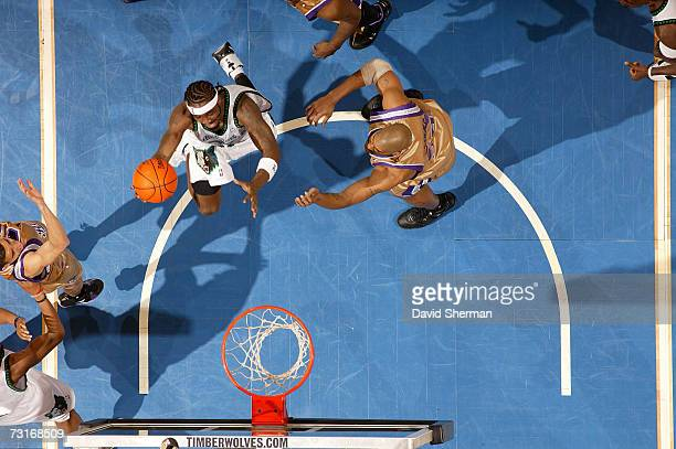 Ricky Davis of the Minnesota Timberwolves drives to the basket against Corliss Williamson and Kevin Martin of the Sacramento Kings on January 31 2007...
