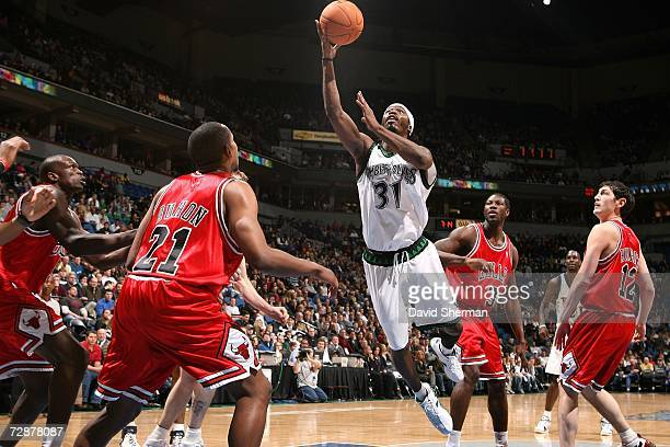 Ricky Davis of the Minnesota Timberwolves goes to the basket against Chris Duhon of the Chicago Bulls on December 26 2006 at the Target Center in...
