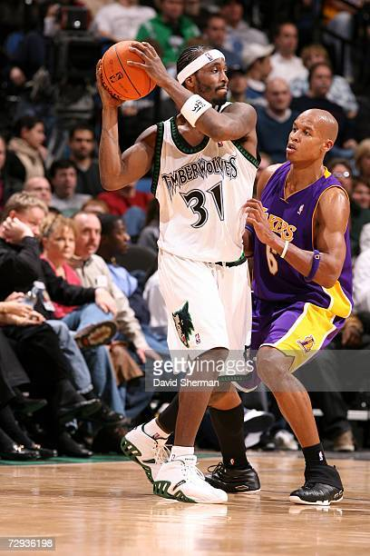 Ricky Davis of the Minnesota Timberwolves is defended by Maurice Evans of the Los Angeles Lakers on December 20 2006 at the Target Center in...