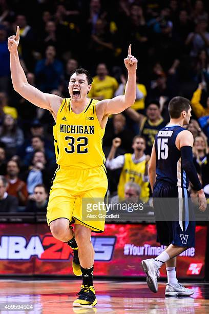 Ricky Doyle of the Michigan Wolverines celebrates a basket in the second half during a game against the Villanova Wildcats in the Progressive Legends...