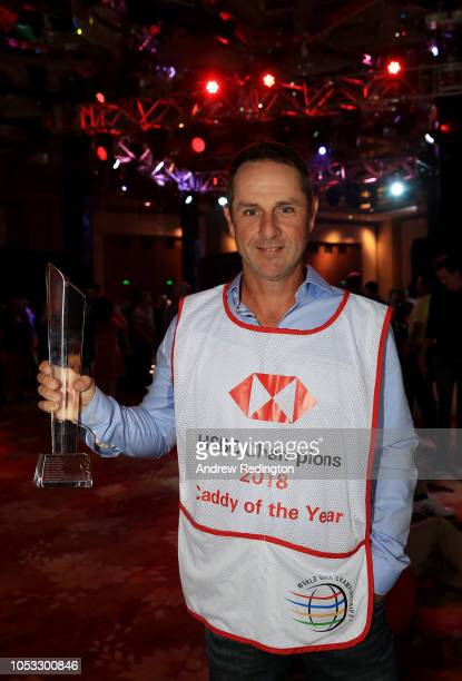 Ricky Elliott caddy for Brooks Koepka of the United States poses with the 2018 Caddy of the Year award after the first round of the WGC HSBC...