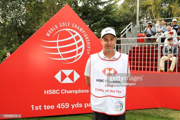 Ricky Elliott caddy for Brooks Koepka of the United States poses with the 2018 Caddy of the Year bib on the first tee during the second round of the...