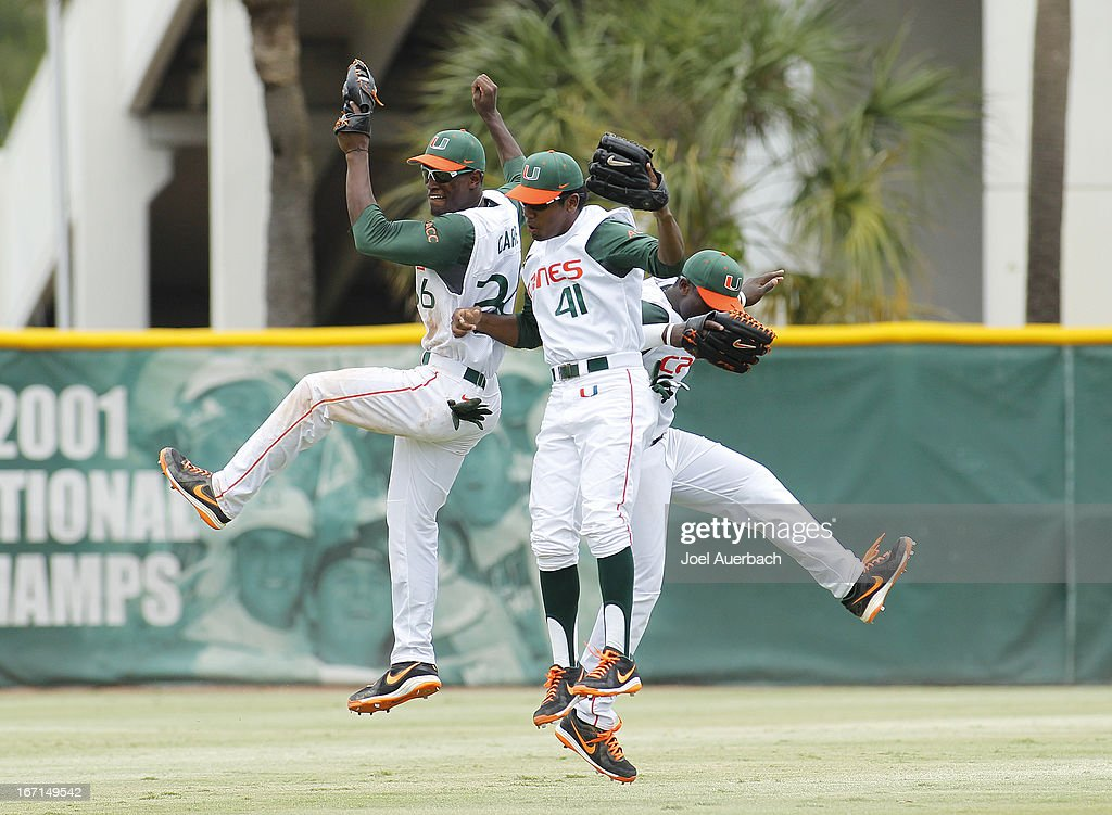 Ricky Eusebio #41, Dale Carey #36, and Chantz Mack #2 of the Miami Hurricanes celebrate their win against the Clemson Tigers on April 21, 2013 at Alex Rodriguez Park at Mark Light Field in Coral Gables, Florida. Miami defeated Clemson 7-0.