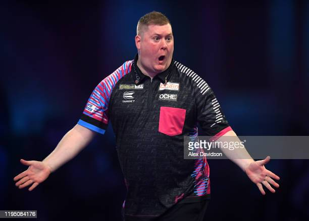 Ricky Evans celebrates victory during the round 2 match between Ricky Evans and Mark McGeeney on Day 8 of the 2020 William Hill World Darts...