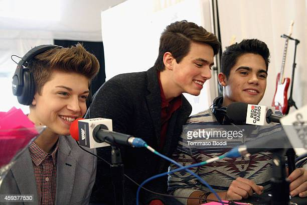 Ricky Garcia Liam Attridge and Emery Kelly of the boy band Forever In Your Mind attend the 2014 American Music Awards Radio Row at Nokia Theatre LA...