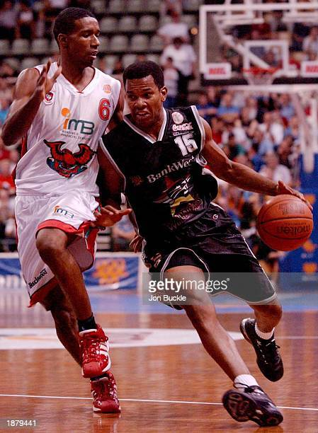 Ricky Grace of the Perth Wildcats drives to the hoop against Wollongong Hawks Cortez Groves during the NBL Basketball game between the Wollongong...
