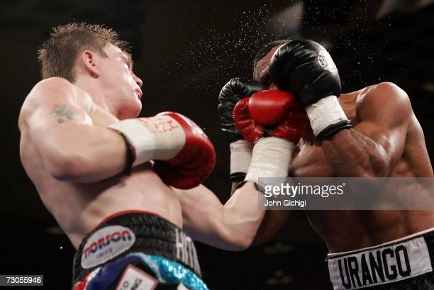 Ricky Hatton of England connects with a left to the face of Juan Urango of Colombia during their junior welterweight title fight on January 20, 2007...