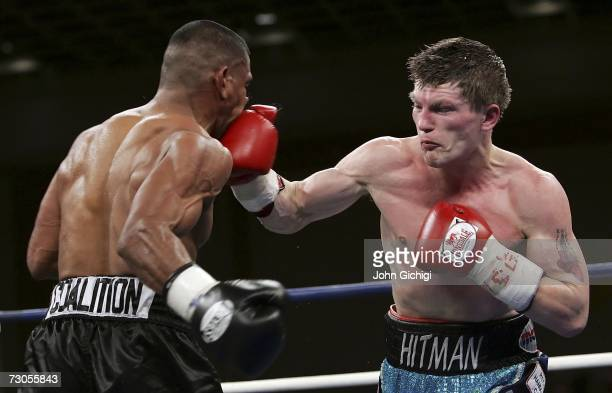 Ricky Hatton of England connects with a right to the face of Juan Urango of Colombia during their junior welterweight title fight on January 20, 2007...