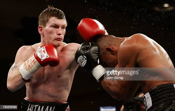 Ricky Hatton of England throws a left to the head of Juan Urango of Colombia as he ducks down during their junior welterweight title fight on January...