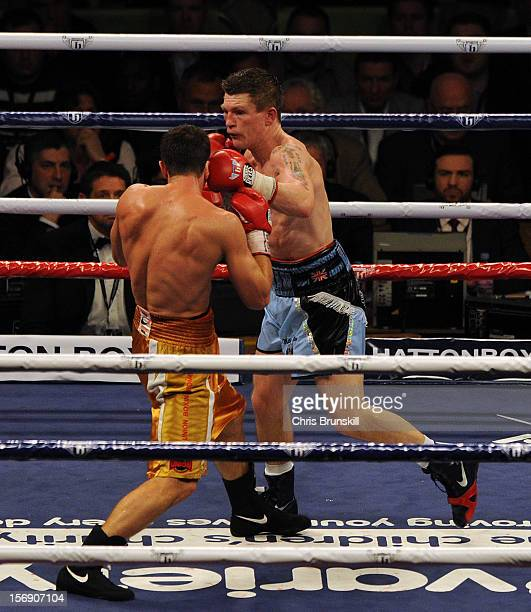 Ricky Hatton of Great Britain and Vyacheslav Senchenko of Ukraine exchange blows during their welterweight bout at MEN Arena on November 24 2012 in...