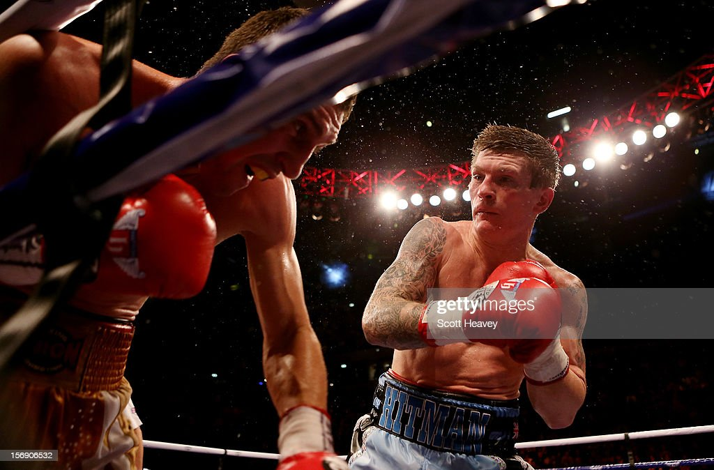 Ricky Hatton of Great Britain in action with Vyacheslav Senchenko of Ukraine during their Welterweight bout at the MEN Arena on November 24, 2012 in Manchester, England.