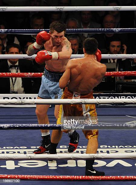 Ricky Hatton of Great Britain in action with Vyacheslav Senchenko of Ukraine during their welterweight bout at MEN Arena on November 24 2012 in...