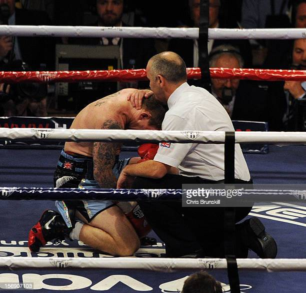 Ricky Hatton of Great Britain is consoled by the referee after being knocked out by Vyacheslav Senchenko of Ukraine during their welterweight bout at...