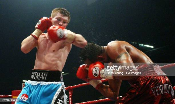 Ricky Hatton puts pressure on Ray Olivera during the WBU LightWelterweight Championship fight at the EXCEL centre east London