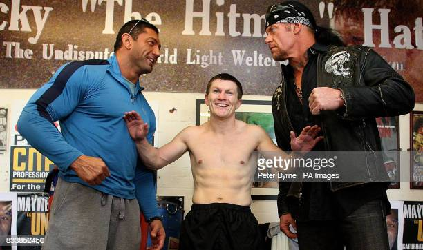 Ricky Hatton separates WWE stars Batista and the Undertaker during a vist to the Manchester Boxers Gym in Denton