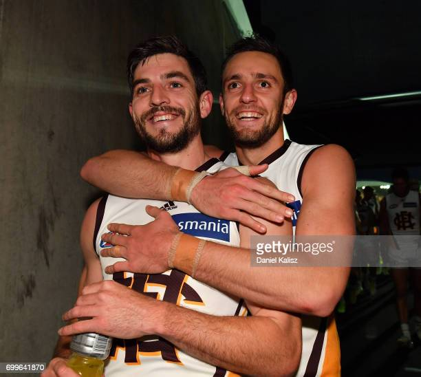Ricky Henderson and Jack Gunston of the Hawks celebrate after the round 14 AFL match between the Adelaide Crows and the Hawthorn Hawks at Adelaide...