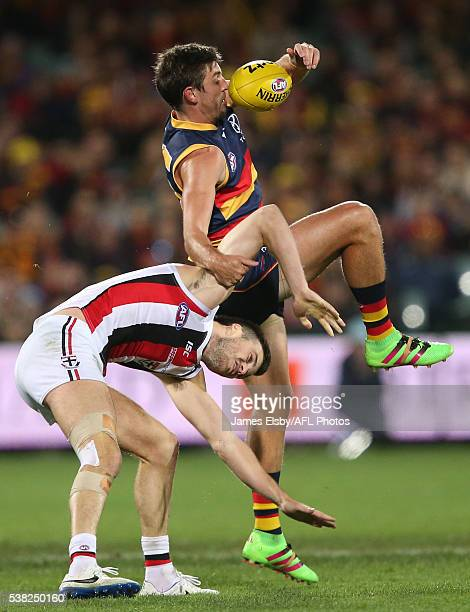 Ricky Henderson of the Crows clashes withDylan Roberton of the Saints during the 2016 AFL Round 11 match between the Adelaide Crows and the St Kilda...