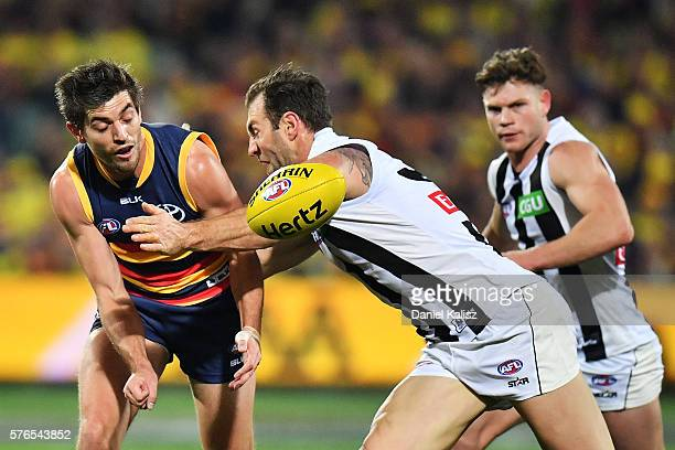 Ricky Henderson of the Crows competes for the ball with Travis Cloke of the Magpies during the round 17 AFL match between the Adelaide Crows and the...