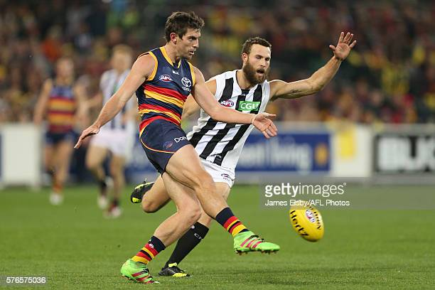 Ricky Henderson of the Crows is tackled by Brent Macaffer of the Magpies during the 2016 AFL Round 17 match between the Adelaide Crows and the...