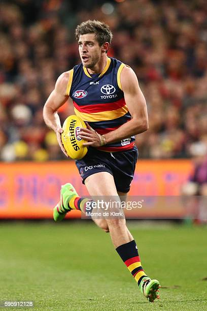 Ricky Henderson of the Crows runs with the ball during the round 23 AFL match between the Adelaide Crows and the West Coast Eagles at Adelaide Oval...