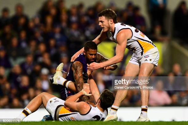 Ricky Henderson of the Hawks and Bradley Hill of the Dockers wrestle on there turf during the 2017 AFL round 18 match between the Fremantle Dockers...