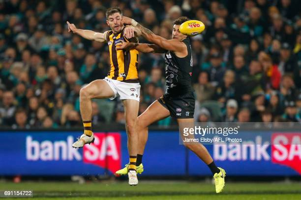 Ricky Henderson of the Hawks competes with Brendon Ah Chee of the Power during the 2017 AFL round 11 match between Port Adelaide Power and the...