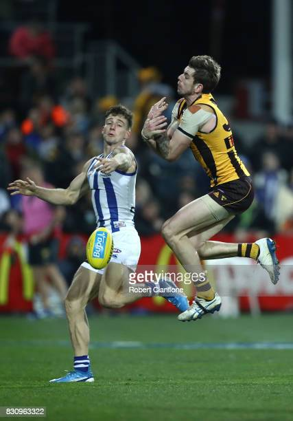 Ricky Henderson of the Hawks fails to hold the ball during the round 21 AFL match between the Hawthorn Hawks and the North Melbourne Kangaroos at...