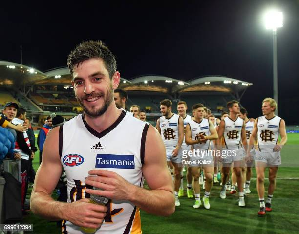 Ricky Henderson of the Hawks leads his team from the field after the round 14 AFL match between the Adelaide Crows and the Hawthorn Hawks at Adelaide...
